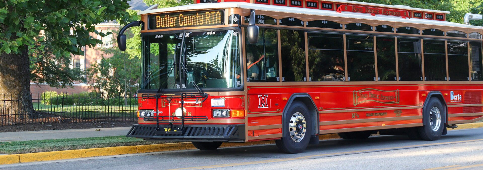The Miami University Trolley at a bus stop