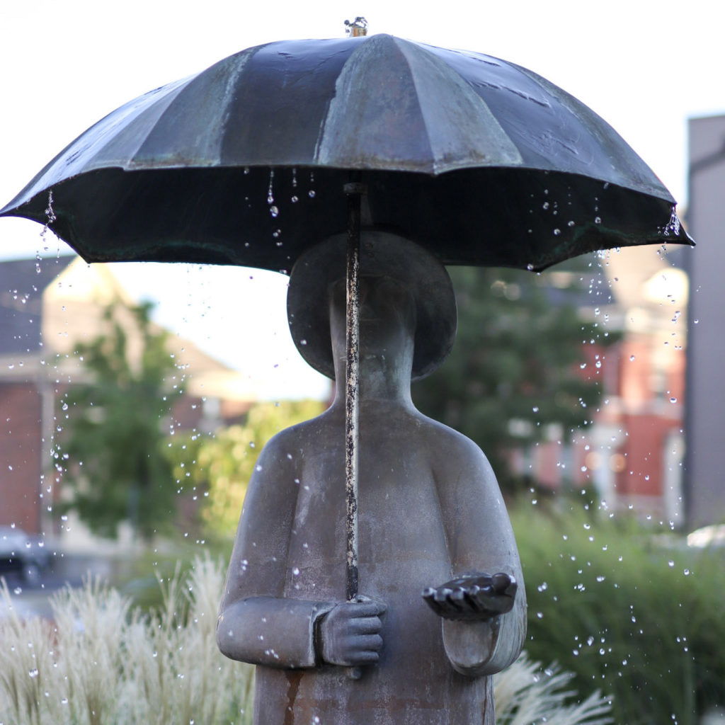 statute of a person holding an umbrella